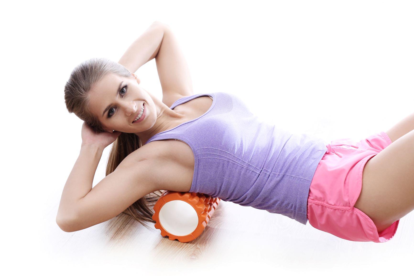 here is a woman using a foam roller